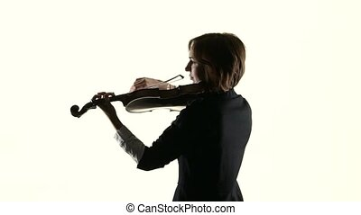 Girl performs on a violin in a white studio.White background. Slow motion