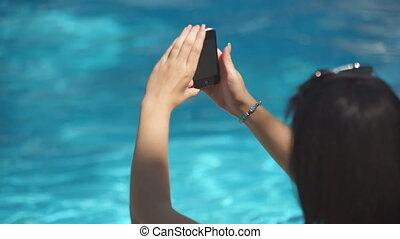 Girl phone pool