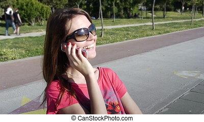 Girl phone talking park smile