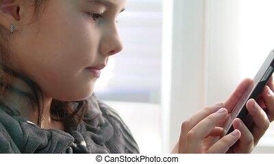 Girl phone teenager smartphone online game website the surfing