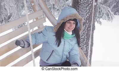 Girl photographed oneself on swing