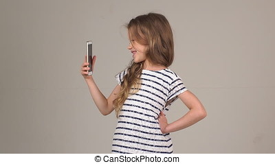 girl photographs herself on camera mobile phone