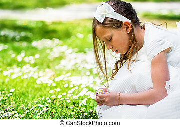 Girl picking flowers.
