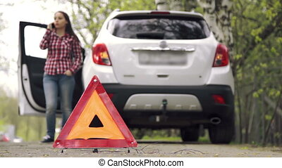 Girl picks up the warning triangle and drives away - Young...
