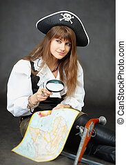 Girl - pirate sitting with a map and magnifying glass