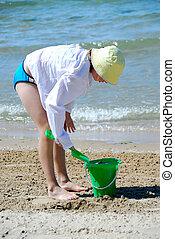 Girl play beach