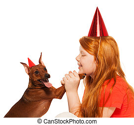 Girl play birthday party for pet dog