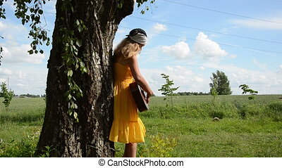 girl play guitar tree