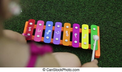 girl play on xylophone - girl playing the xylophone close-up
