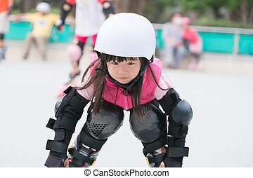 girl play roller skating - close up of cute girl play roller...