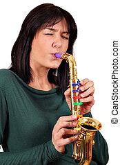 girl play saxophone