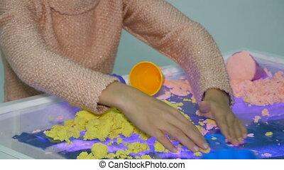 girl play with kinetic sand