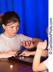 Girl playing a board game
