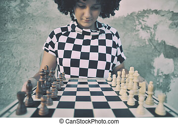 Girl playing a game of chess.