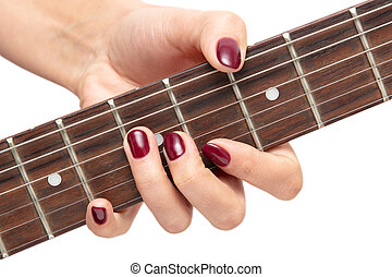 Girl playing an electric guitar on white background