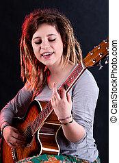 Girl playing and singing