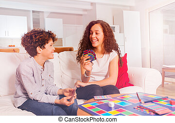 Girl playing card games with her younger brother