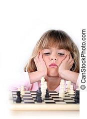 Girl playing chess