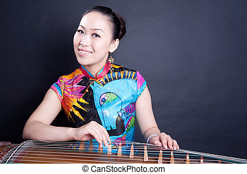 girl playing Chinese zither