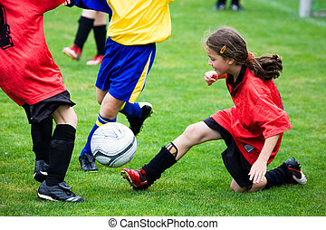 Young girl playing soccer
