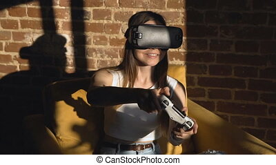Girl Playing Game in VR Helm - Dark hair caucasian girl...