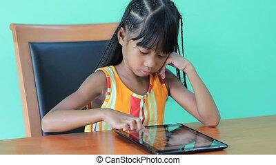 Girl Playing Game On Digital Tablet