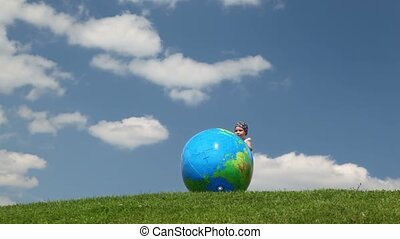 Girl playing globe looking inflatable ball
