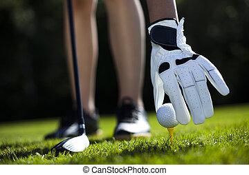 Girl playing golf on grass