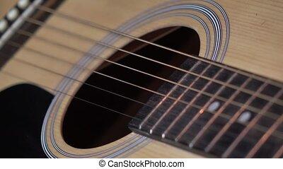 Girl playing guitar, close up