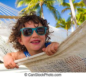 Girl playing hammock