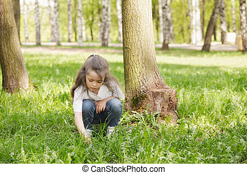 Girl playing in grass
