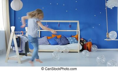 Girl playing in her bedroom movie - Happy blonde girl...