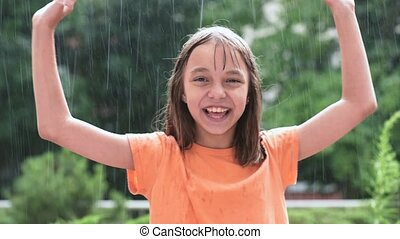 Girl playing in rain