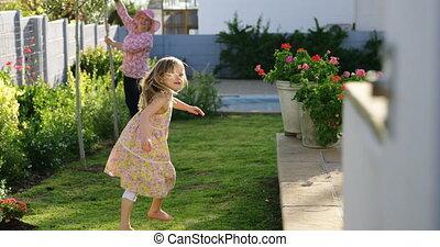 Girl playing in the garden 4k