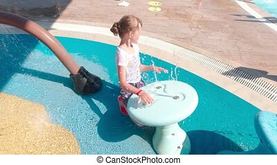 Girl Playing In The Water Park