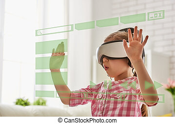 girl playing in virtual reality glasses