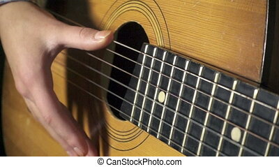 Girl playing on acoustic guitar, slow motion 500 fps -...