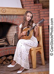 Girl playing on Mandolin