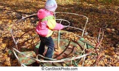 girl playing on playground in park