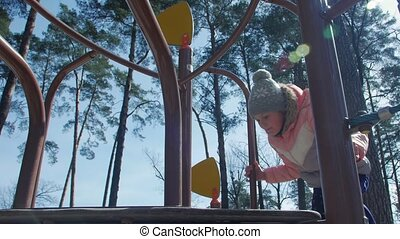 Girl Playing On The Playground
