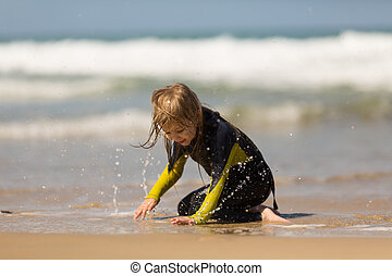 Girl playing on the sea, sprinkles water