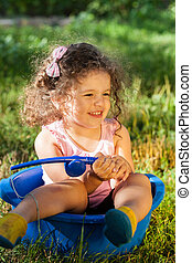Girl playing outdoors