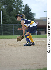 Girl Playing Second Base on Softball Field - Girl in...