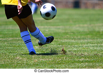 Girl playing soccer on the field.