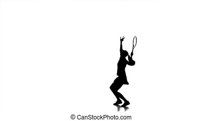 Girl is engaged in tennis racket hits the ball bounces hair in different directions. Silhouette. White background. Slow motion