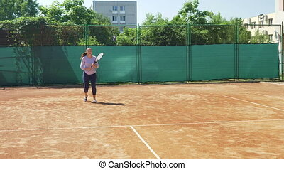 Girl playing tennis match and training to win