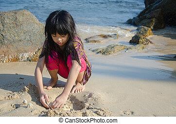 Girl playing the beach