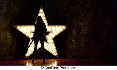 girl playing the electric guitar, slow motion, silhouette