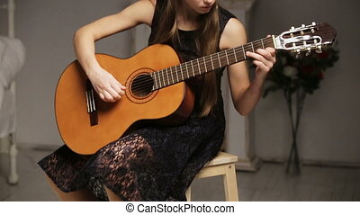 Girl playing the guitar