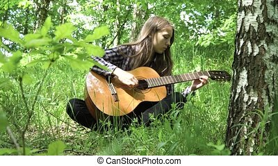 Girl playing the guitar. - Young girl in forest with guitar...